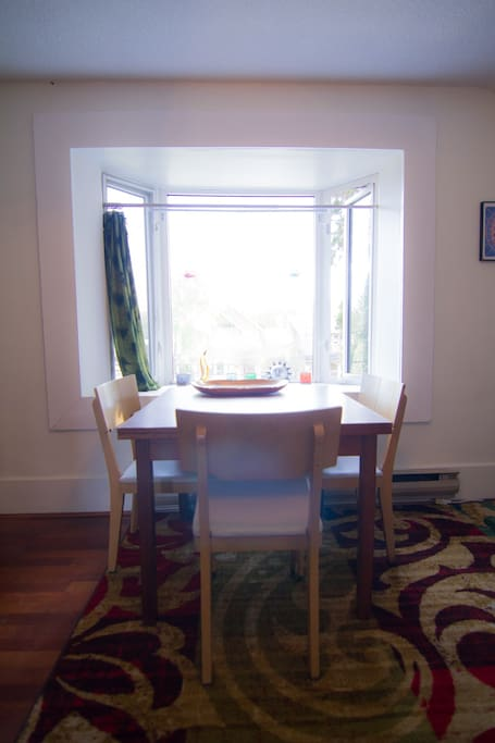 Dining table set in a south facing bay window
