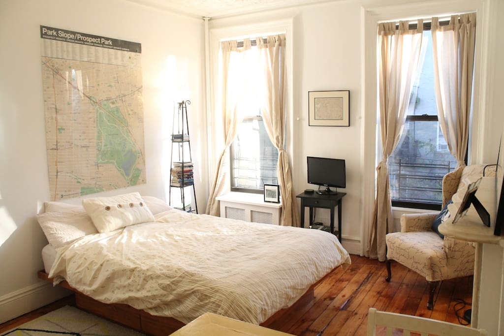 Above the bed is a large neighborhood map to get you oriented. The TV gets local channels and Netflix!