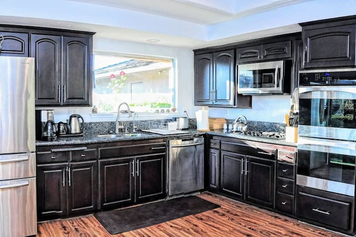 Gourmet Kitchen with top of the line appliances and cooking utensils