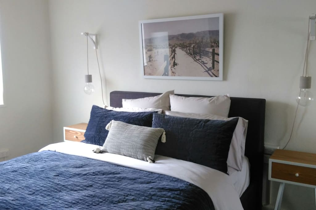 Queen bed with bamboo cotton sheets and a range of pillows to  choose from.