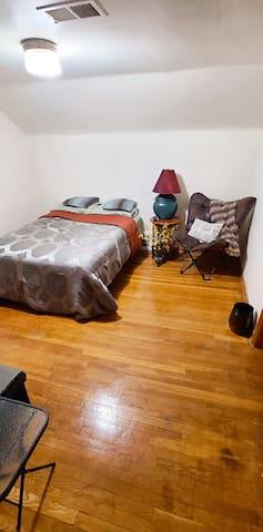 Second Floor Bedroom with queen size bed. Smart flat screen TV. Bonus room for relaxing or working.