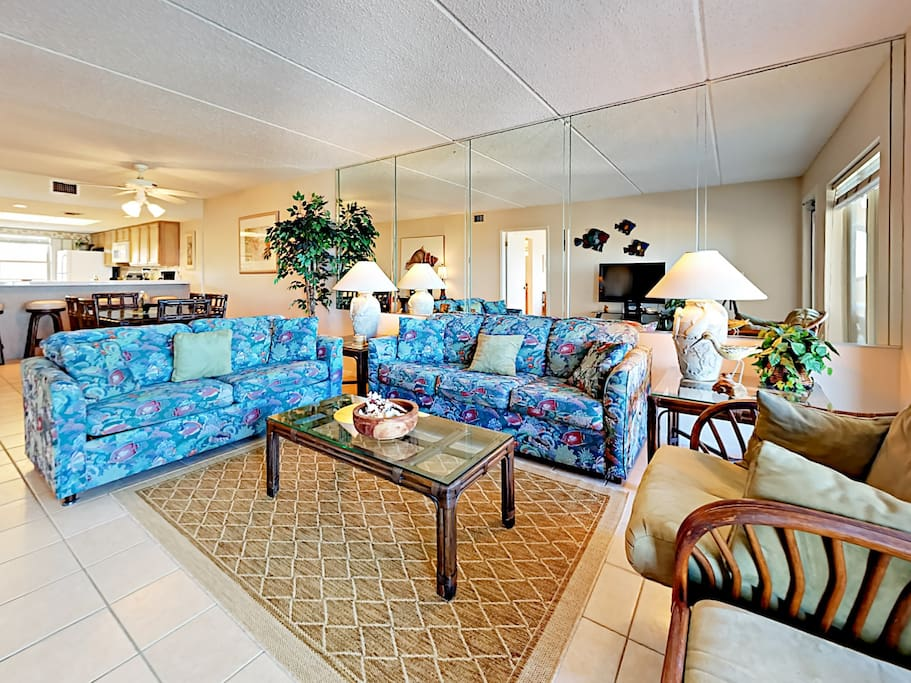 Decorated with classic beach-inspired design elements and tile flooring throughout.