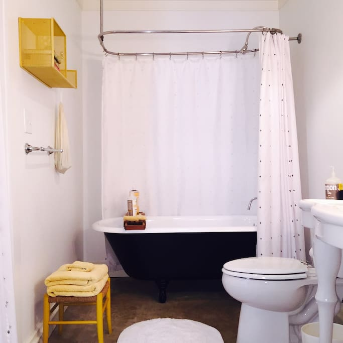 Claw foot soaking tub and all the essentials you need for a short stay.