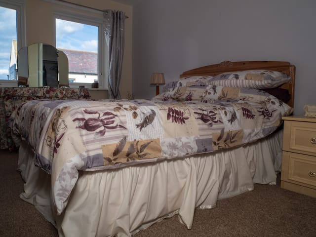 Spacious double bedroom.  Travel cot available.