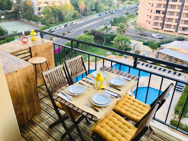 Balcony facing the pool, tennis court and gardens