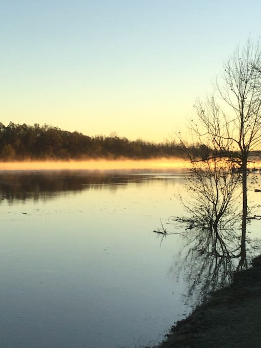 Front view, morning sunrise with mists rising on the river.