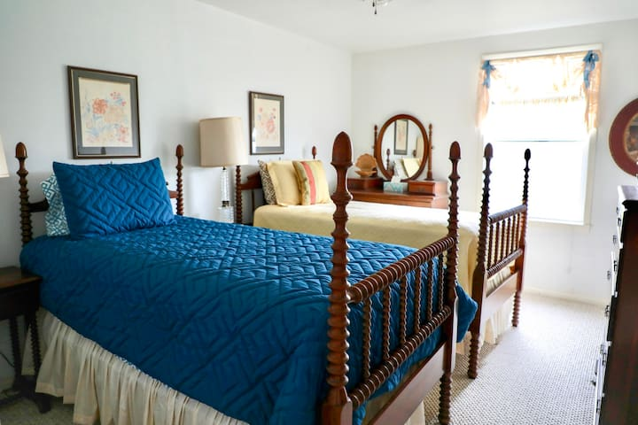 Bedroom with two twin beds and private bath.