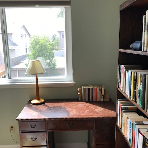 A writing desk with a pleasant view of the garden.