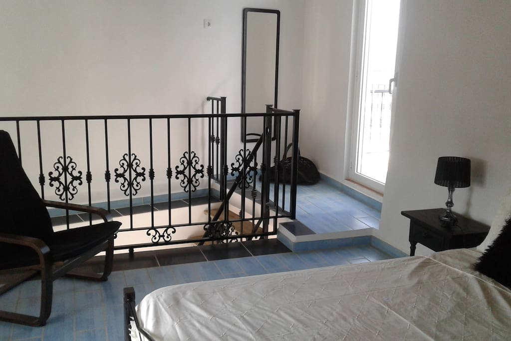 Large roomy bedroom with door onto the private terrace.