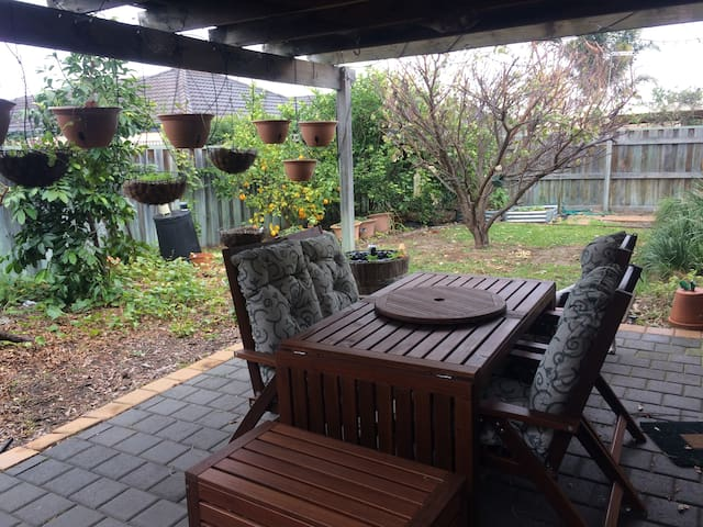 The back garden provides a lovely quiet space that can be used in all weather.
