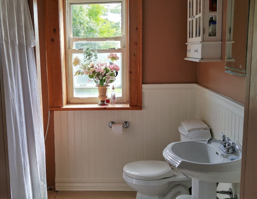 The shared bathroom was a child's bedroom back in the day. We have upgraded from the outhouse (still on the property), but it is still a work in progress :)