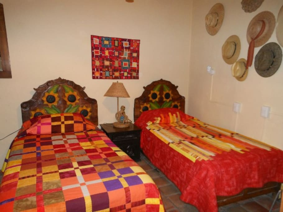 ...One of the bedrooms showing hand made quilts