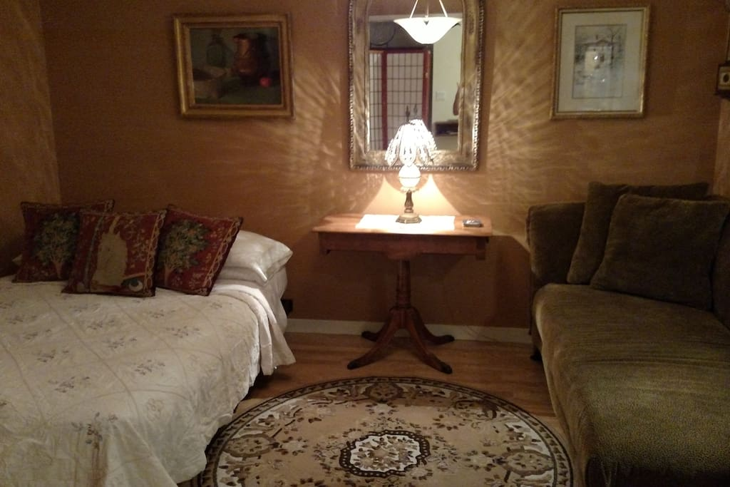 Bedroom 2 at night ~ futon bed open and chaise lounge