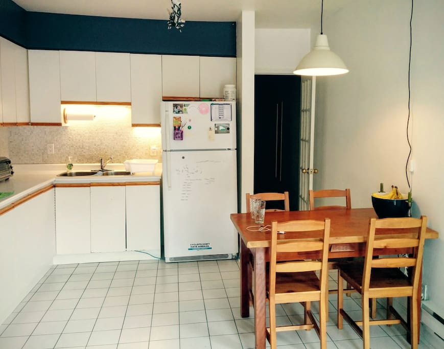 Eat-in kitchen with cupboard and fridge space for guests (standard appliances also shared)