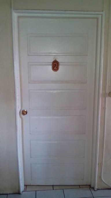 Room 2, closed door.