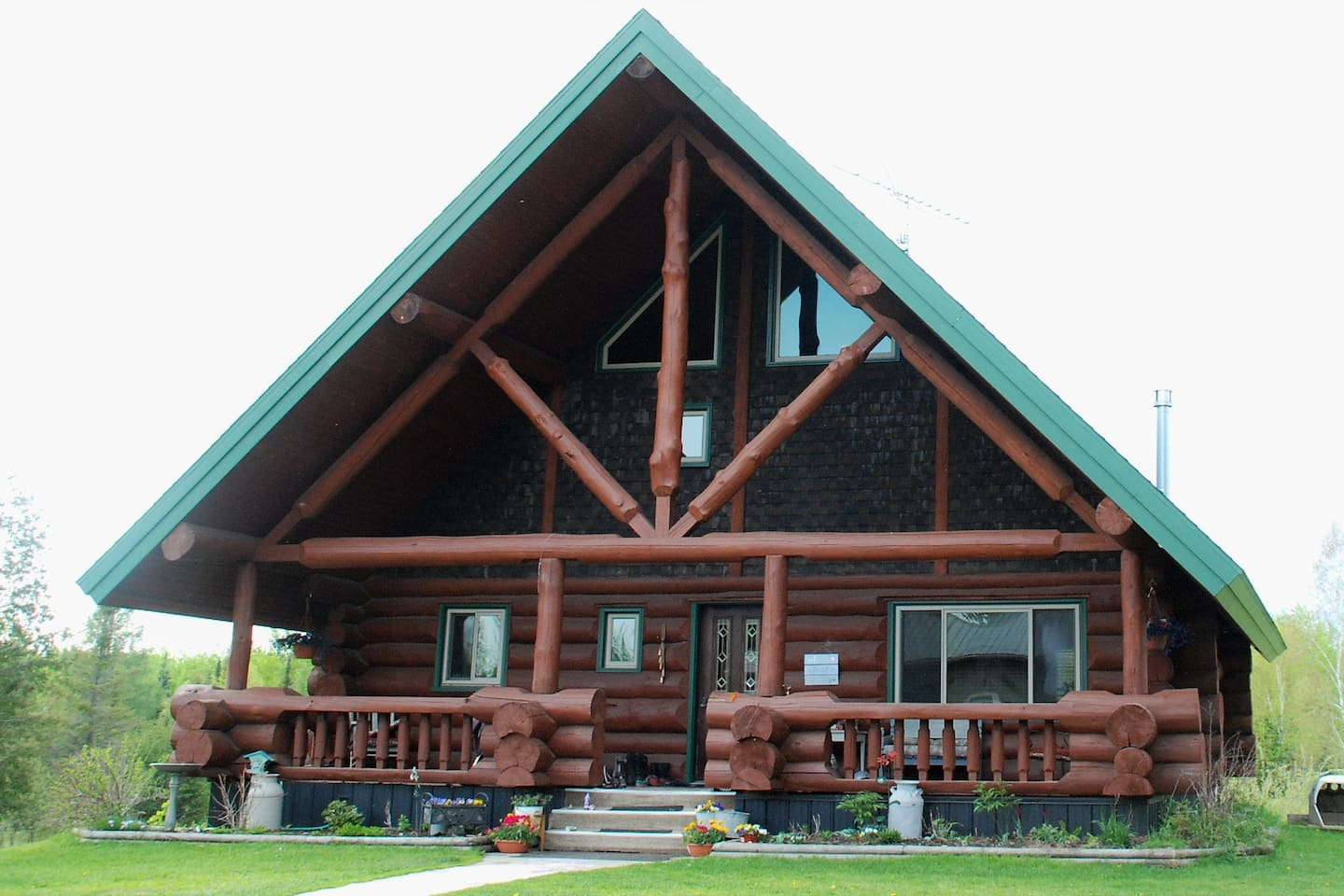 The main house is a beautiful custom log home built in 2005. The shared bathrooms and kitchen are located inside just a short walk from the guest space.