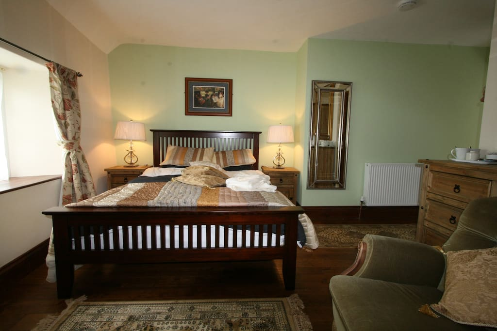 All 3 bedrooms have ensuites and power showers.  This large room also has the bath