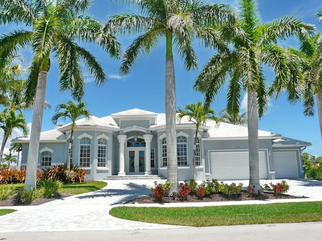 Dazzling waterfront home w/ heated pool, outdoor kitchen & fitness room