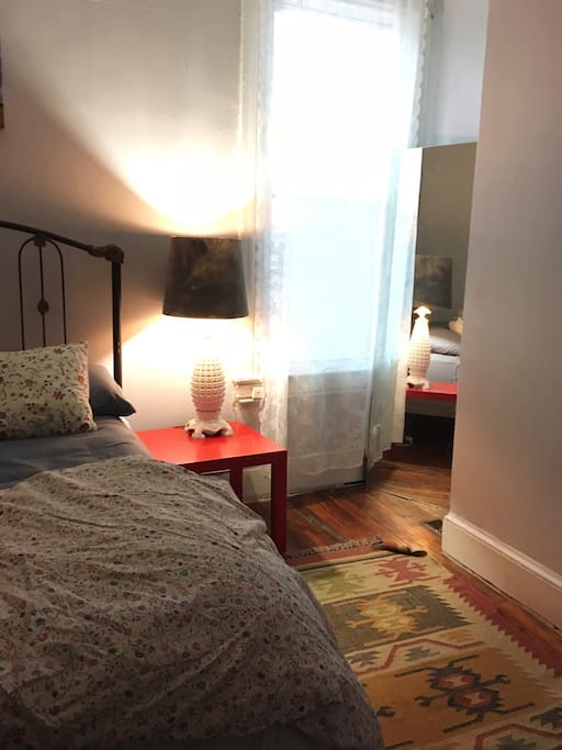 The room features a double bed