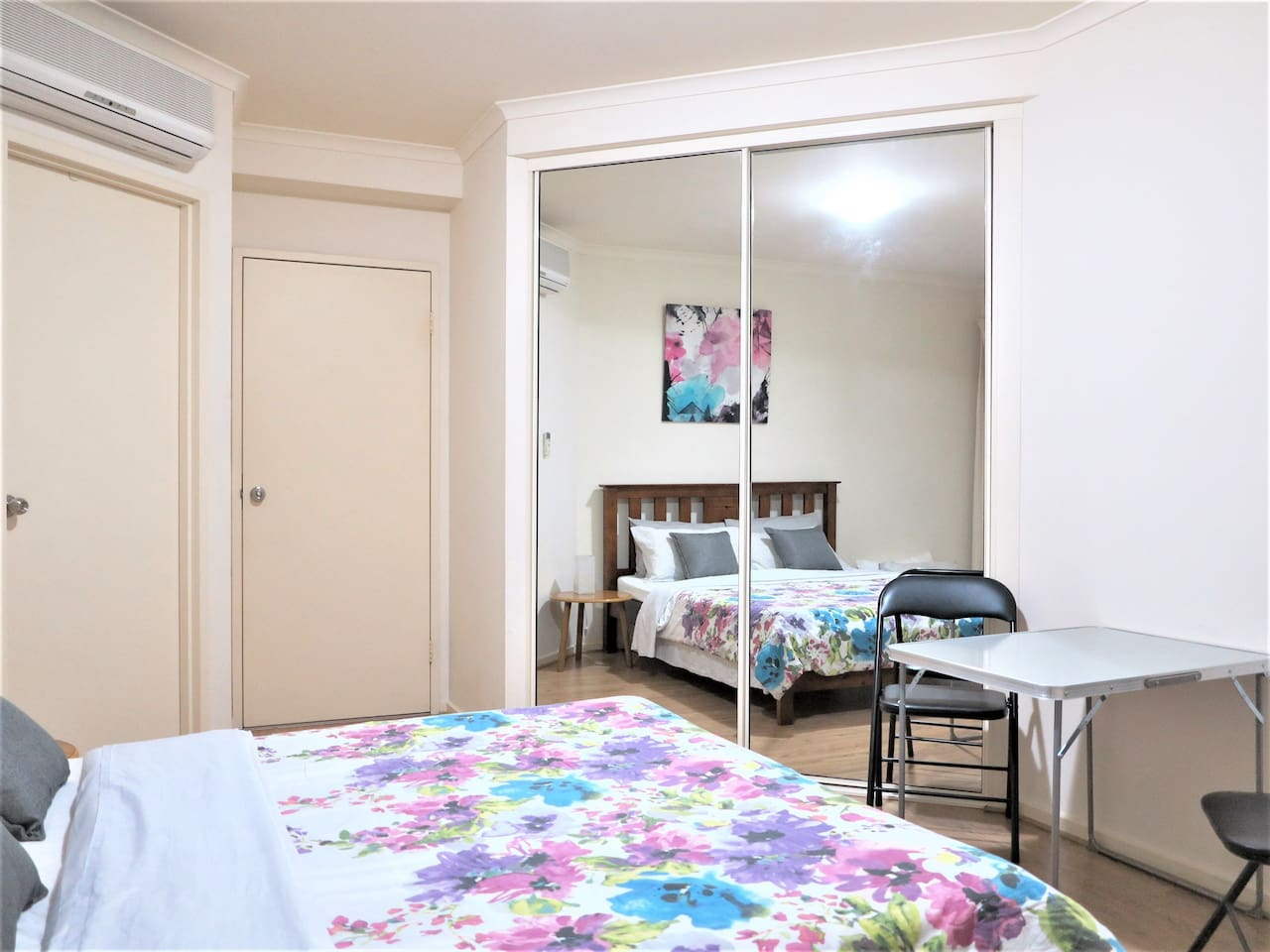 The room with a nice queen size bed and ensuite