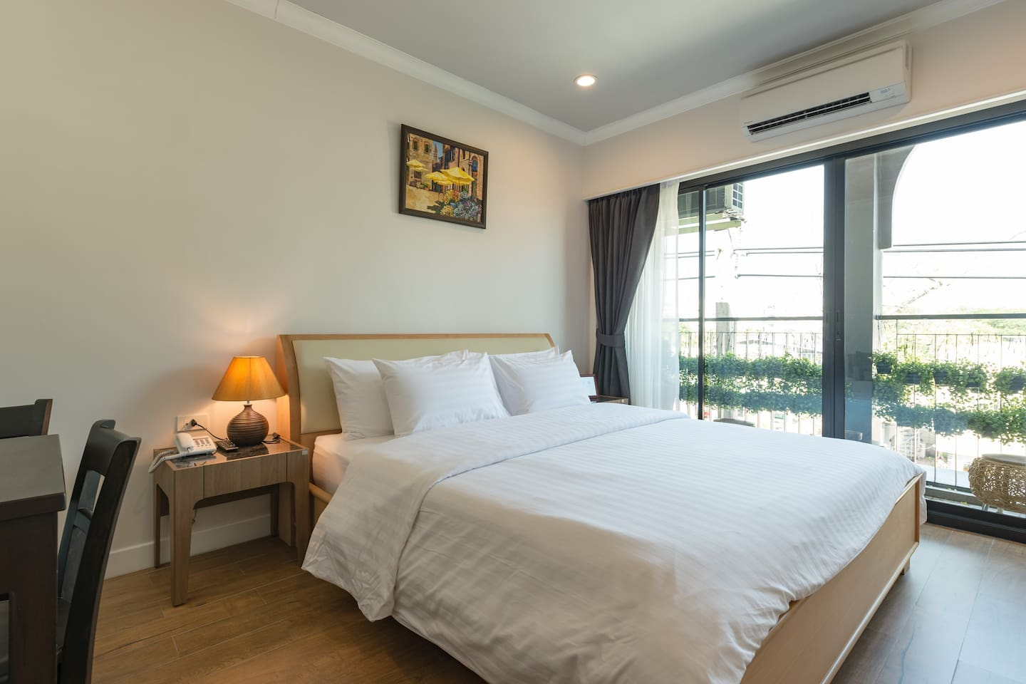Comfortable king size bed with balcony.
