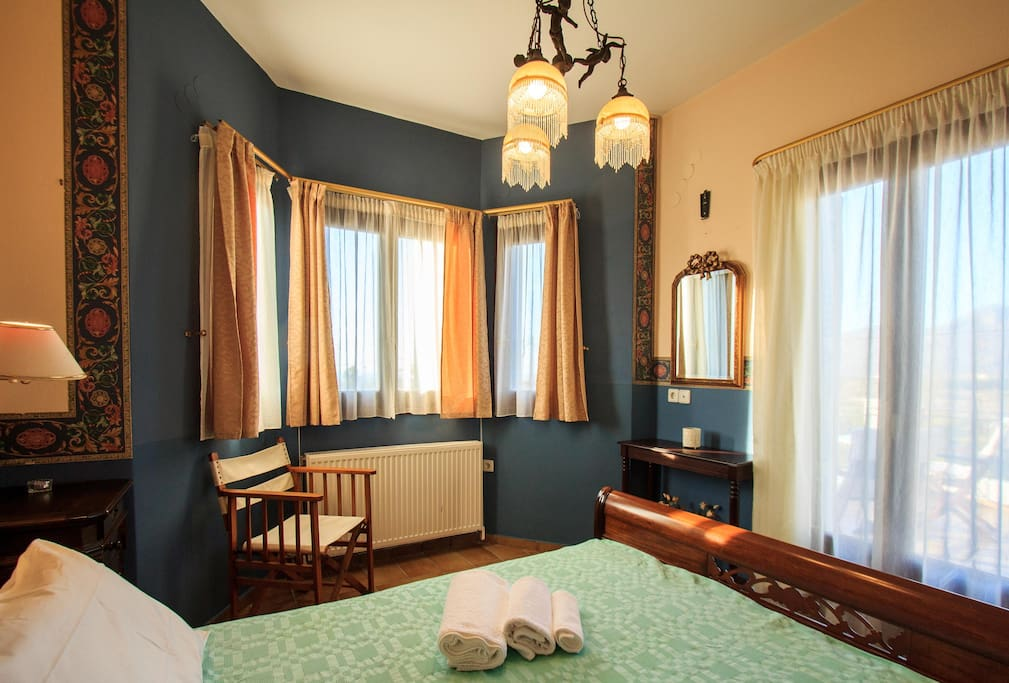 Master bedroom with a large queen sized italian custom made bed