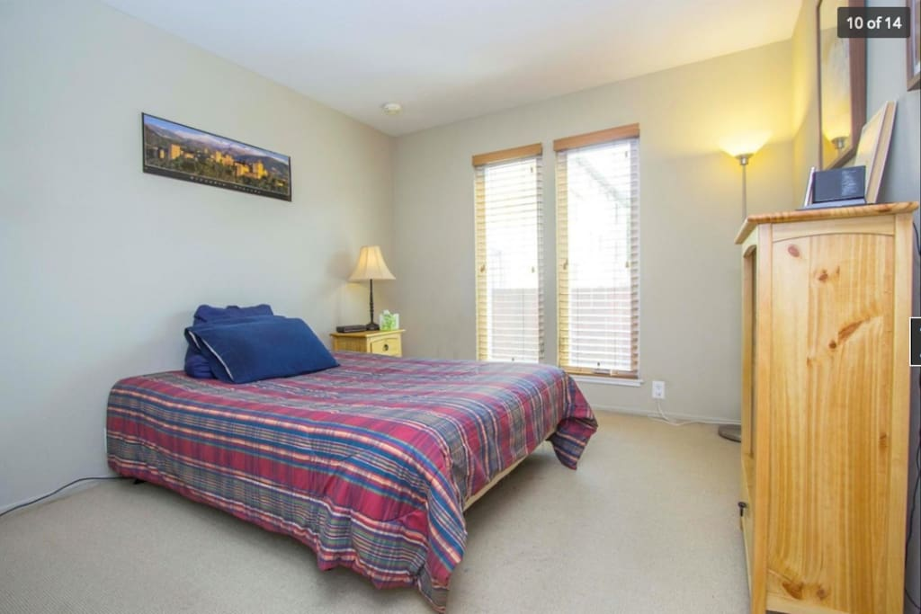 Clean bedroom that gets plenty of sunshine and fresh air flow.