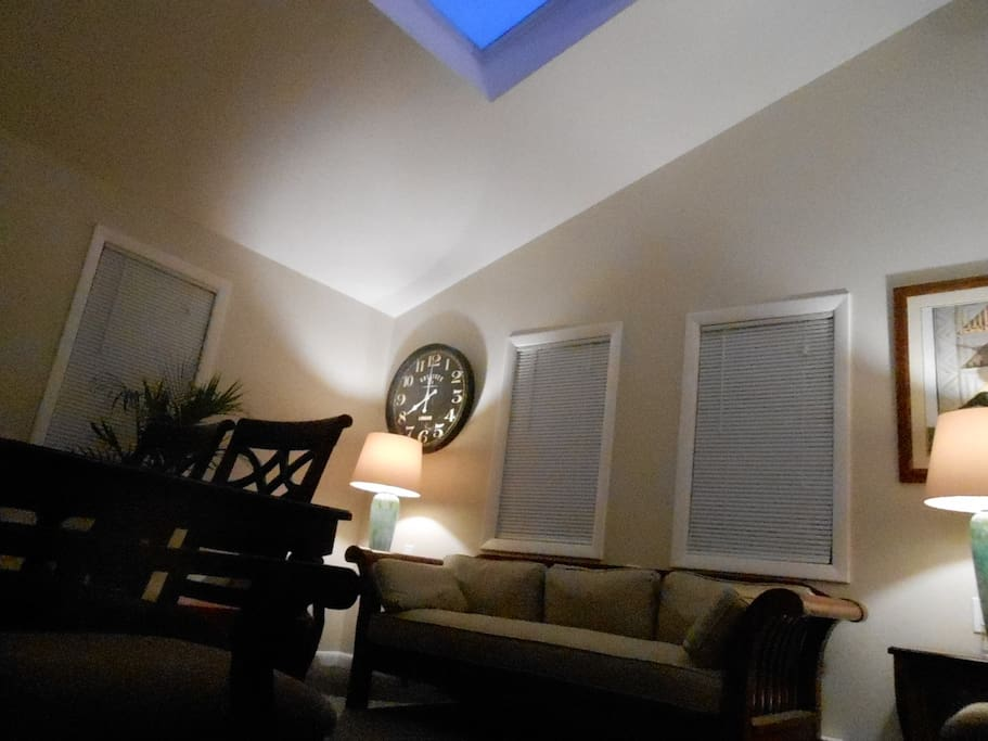 Living room cathedral ceiling with dramatic skylight