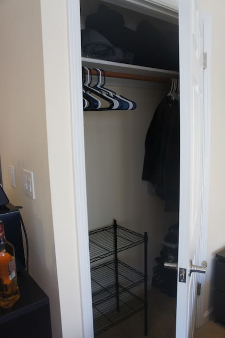 A lot of closet space for a traveler. I left some clothes packed into the corner, but there is a lot of space left for guests to use