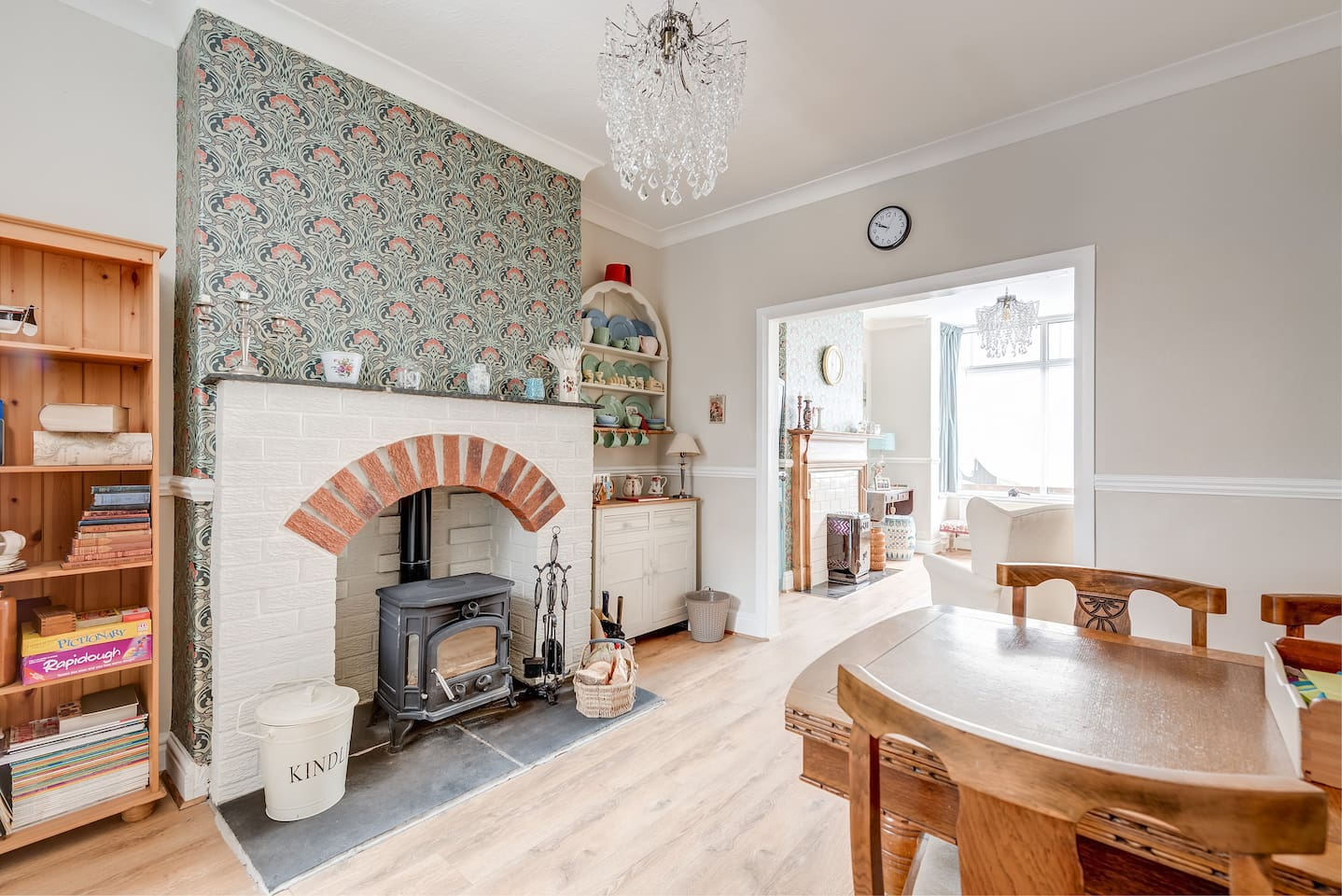 Spacious through dining room with wood burner.