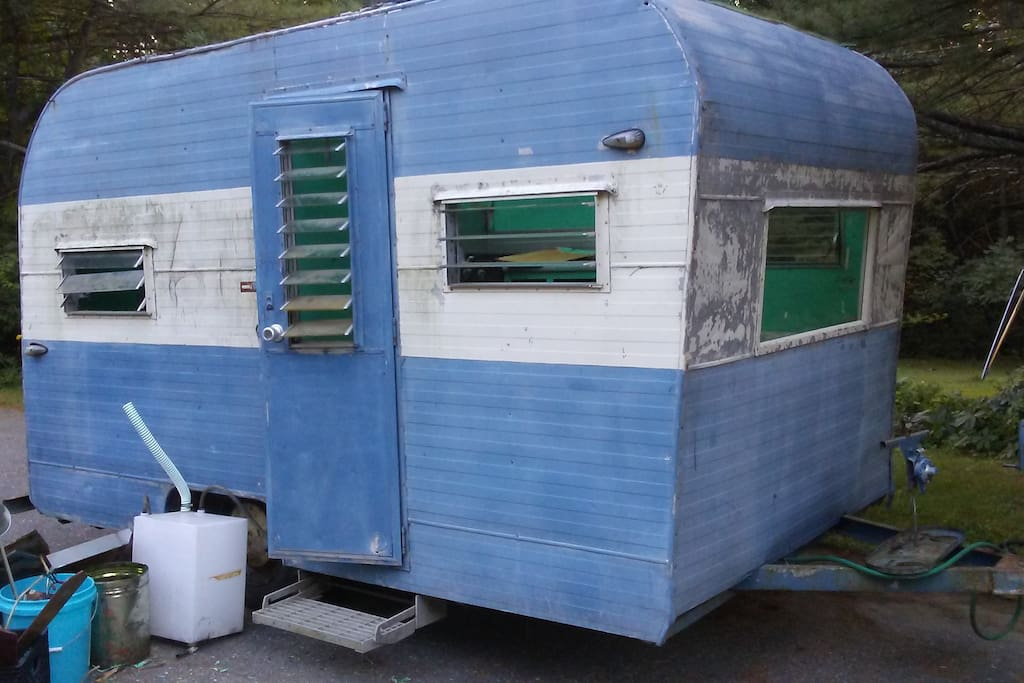 Small (7' x 12')  1960s Camper.  Sleeps two. All new screens. Electricity and cold running water.   And your own Porta Potty out house.