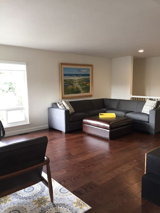 Extended living room with comfy l-shaped sofa