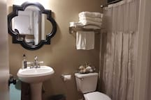 Full size shower and tub. Spa quality towels. Shampoo, conditioner, soap and hair dryer provided
