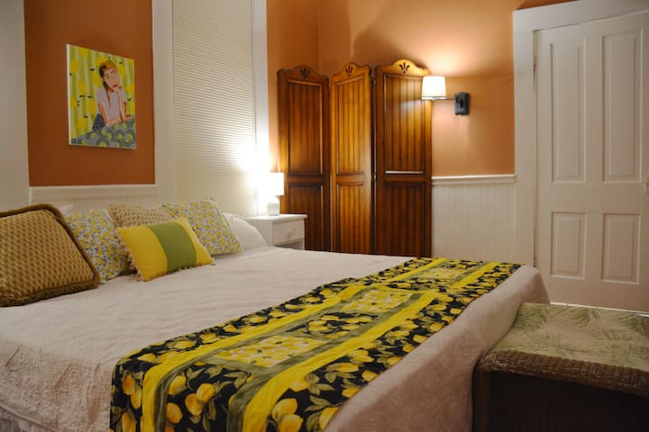 Bedroom 4, The Lemon Room. Downstairs, attached private bath has an antique clawfoot tub.