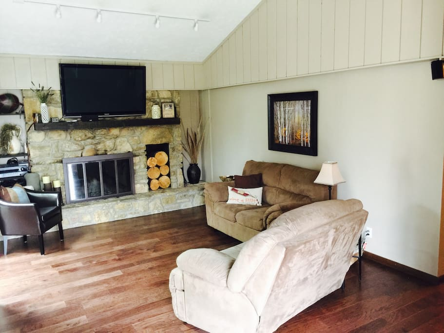 Living Room with fire place adjacent to kitchen