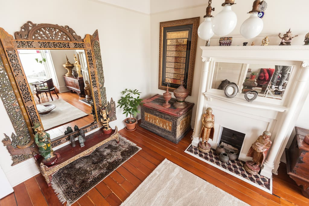 Family room with original hardwood floors, Victorian fixtures and Asian antiques from Burma and Indonesia