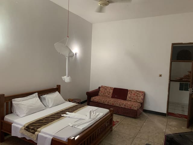 Spacious room with fresh paint, mosquito netting and sitting area