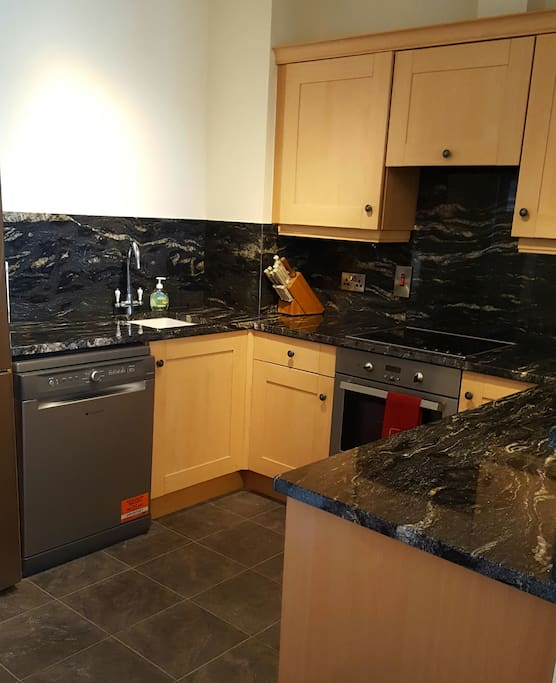 Granite counter top in a well stocked kitchen