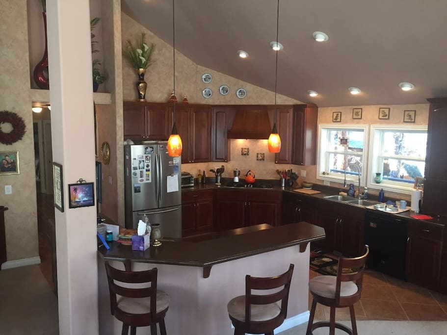 Open Concept Gourmet Kitchen, large island & 3 bar stools