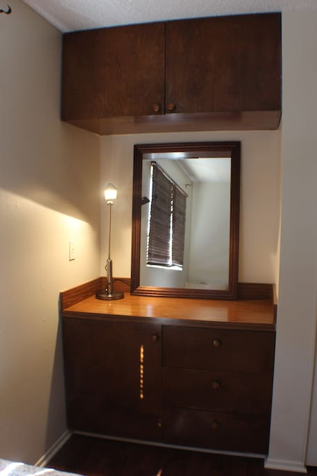 Vanity desk with lamp.
