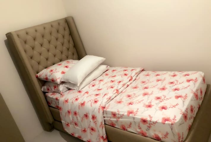 Single bed with pull out, sleeps 2 or more.