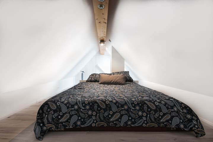 Cozy sleeping place under the roof.