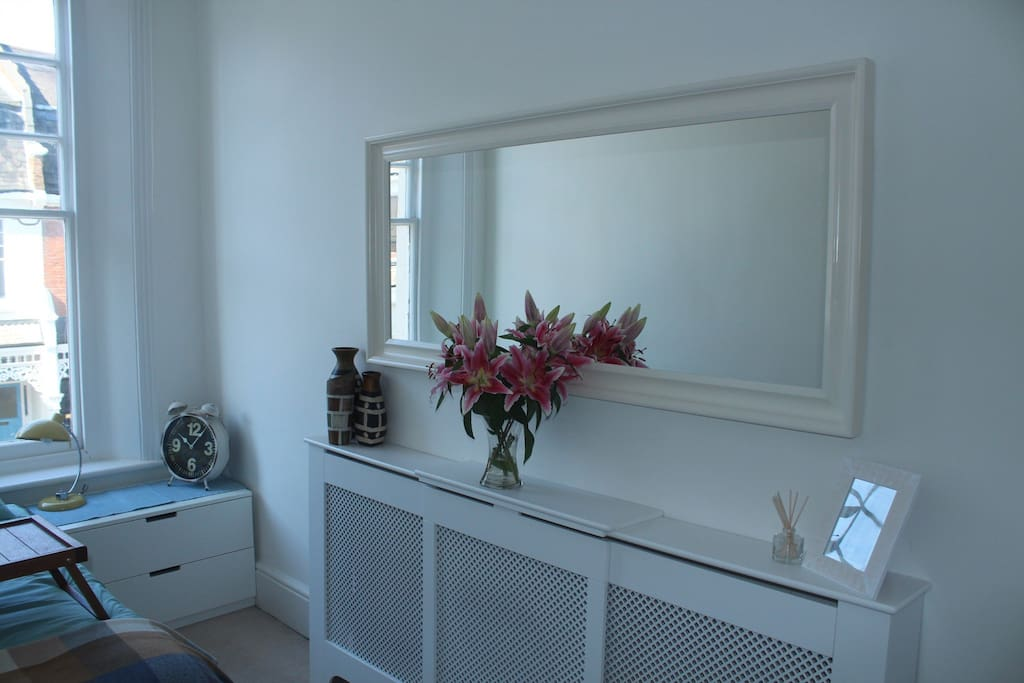 Large mirror and mini dressing table.