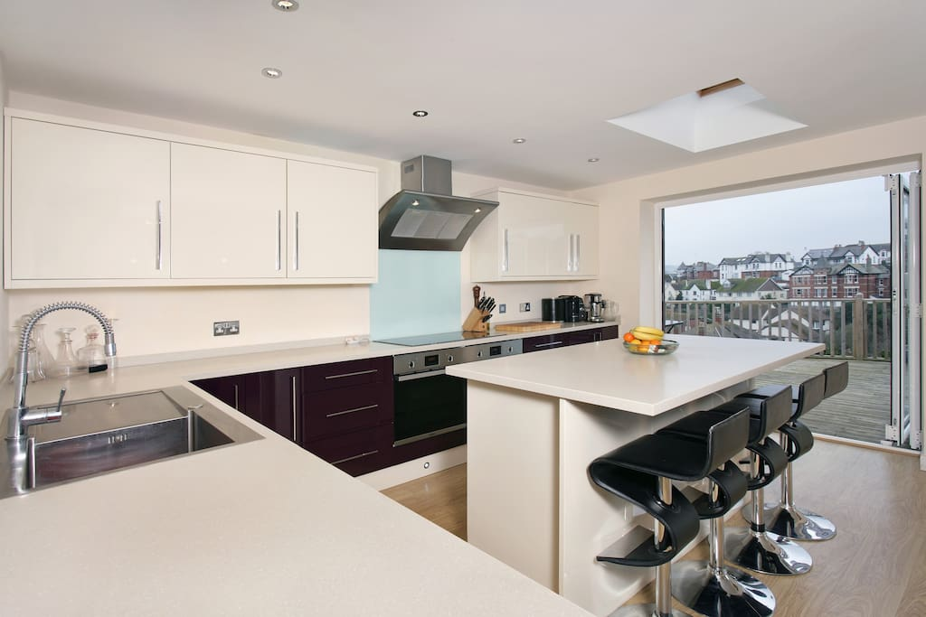 Modern fully fitted kitchen and sociable central island.