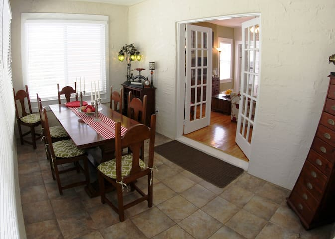 Tiled bright and airy Dining room (french doors leading through to the living room)