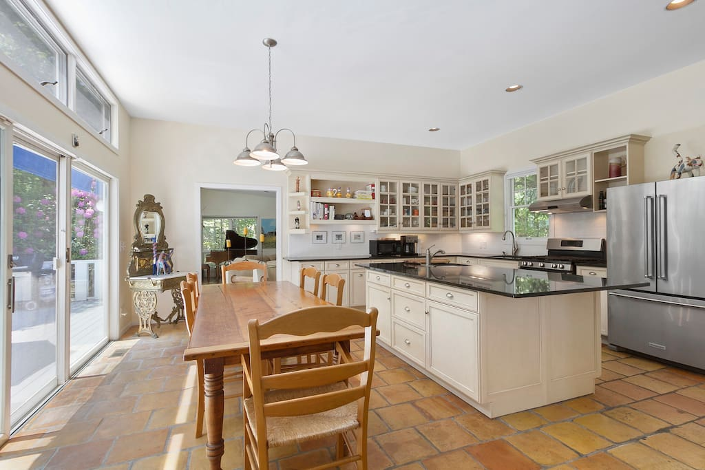 Professional chef's kitchen opens onto dining area that easily seats 8 to 10