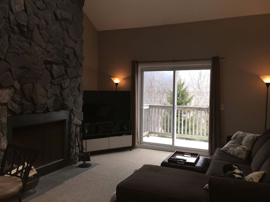 Living area, with fireplace, smart tv and access to small front balcony