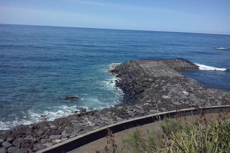 Casa junto ao mar