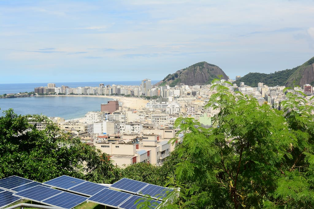 Our green roof with solar panels with Copacabana on the back-ground
