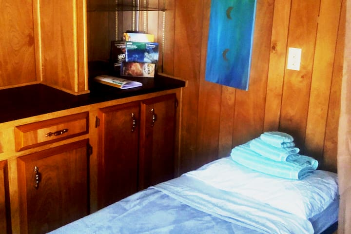 """Your """"semi private"""" space with 6.5ft single person cot with mattress top and fresh bedding, plus a large privacy curtain for light blocking, noise reduction, and privacy."""